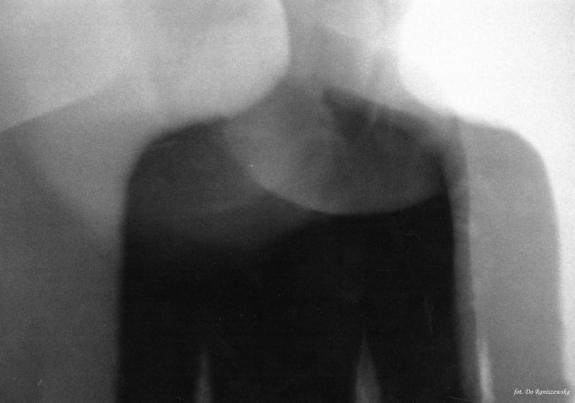 Close up of woman's body with blurred movement in a black and white film photo